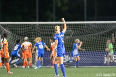Boston Breakers defender Megan Oyster (4) celebrates teammate Natasha Dowie's goal.