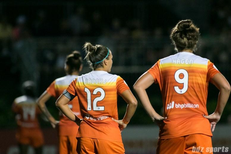 Houston Dash midfielder Amber Brooks (12) and forward Sarah Hagen (9)