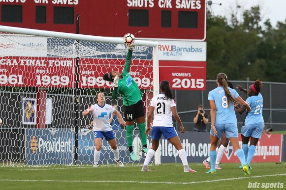 Boston Breakers goalkeeper Abby Smith (14) pushes the ball over the crossbar