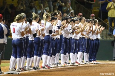The USSSA Pride cheer on teammate USSSA Pride catcher Chelsea Goodacre (77) who received the Rawlings Golden Glove