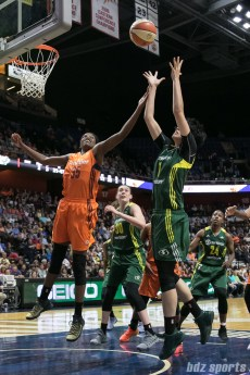 Connecticut Sun center Jonquel Jones (35) and Seattle Storm forward Ramu Tokashiki (7) look to grab the rebound.