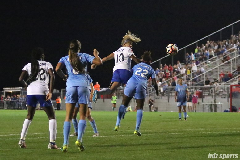 Boston Breakers midfielder Rosie White (10) redirects the ball towards goal with a header