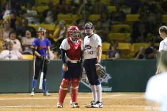 USSSA Pride catcher Chelsea Goodacre (77) talks to pitcher Kelsey Nunley (33) on the mound