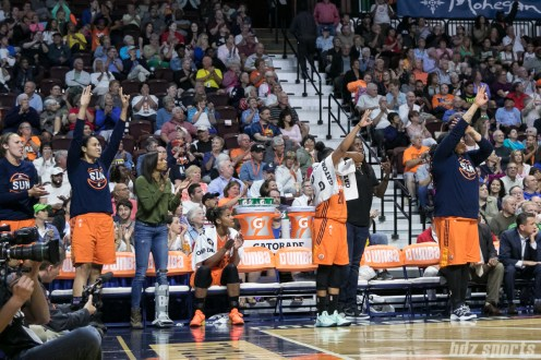 The Sun bench celebrate teammate Courtney Williams' 3-point shot.