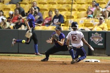 USSSA Pride outfielder Kelly Kretschman (12) beats the throw to third base