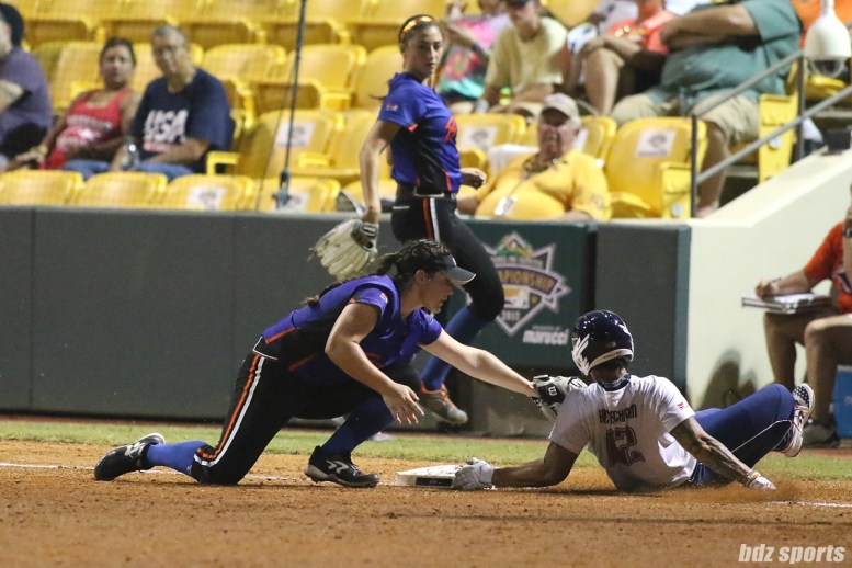 USSSA Pride outfielder Kelly Kretschman (12) beats the tag from Chicago Bandits third baseman Natalie Hernandez (16)