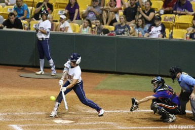 USSSA Pride outfielder Kelly Kretschman (12) makes contact with the ball