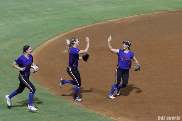 Chicago Bandits infielder Abby Ramirez (11) high fives teammate Brenna Moss (55)