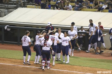 The USSSA Pride high five after getting the final out of the inning