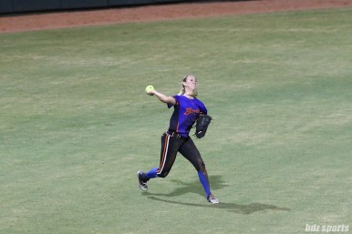 Chicago Bandits outfielder Brenna Moss (55) makes a throw to home plate