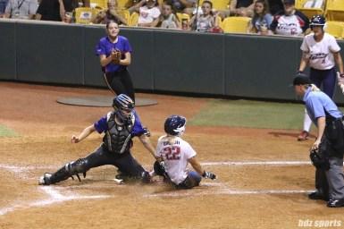 Chicago Bandits catcher Sahvanna Jaquish (33) tags USSSA Pride first baseman Hallie Wilson (22) at home plate