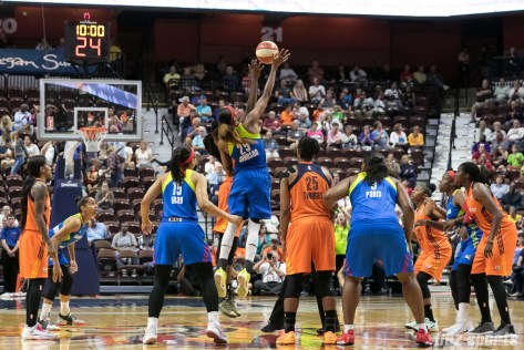 Dallas Wings forward Glory Johnson (25) takes the tip off against Connecticut Sun center Jonquel Jones (35).