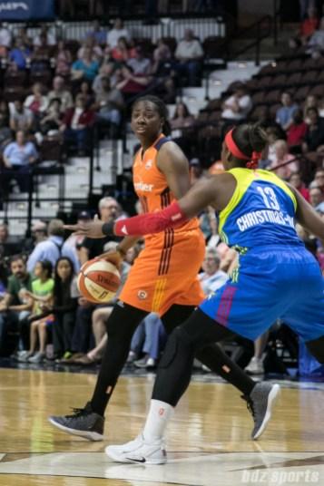 Connecticut Sun forward Shekinna Stricklen (40) controls the basketball for the Sun.