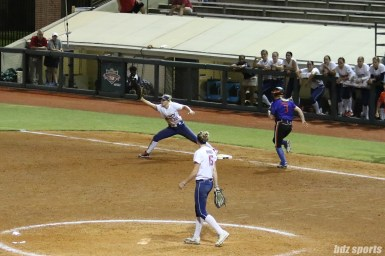 USSSA Pride first baseman Hallie Wilson (22) stretches to catch the out at first