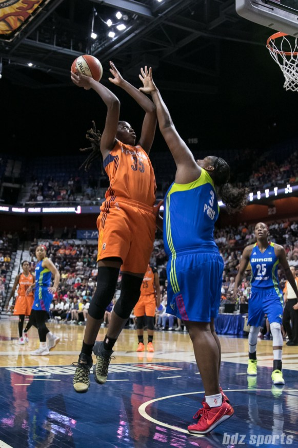Connecticut Sun center Jonquel Jones (35) looks to score a basket while being defended by Dallas Wings center Courtney Paris (3).
