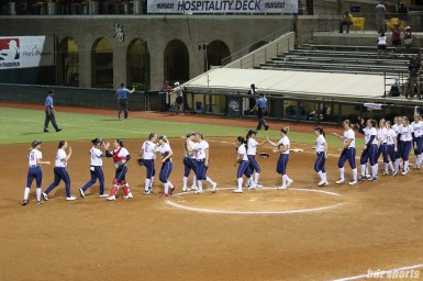 The USSSA Pride high five after defeating the Chicago Bandits 3 - 1 to advance to the NPF Champion Series Final