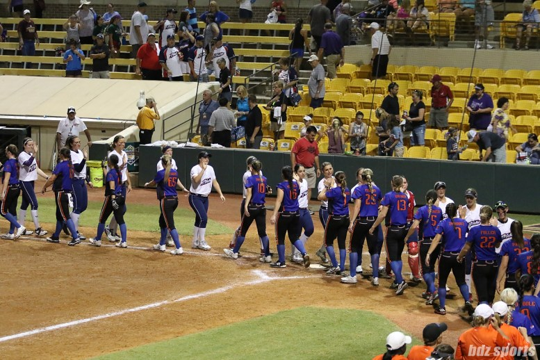 The USSSA Pride and Chicago Bandits shake hands after teh game