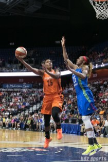 Connecticut Sun forward Alyssa Thomas (25) looks to lay in the basket while being defended by Dallas Wings forward Glory Johnson (25).