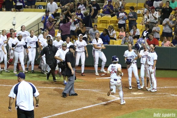 USSSA Pride outfielder Megan Wiggins (25) is greeted by teammates after hitting a 2-run homerun in the bottom of the 5th inning