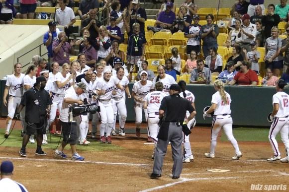 The USSSA Pride celebrate Megan Wiggins (25) 2-run homerun
