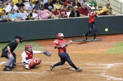 Scrap Yard Dawgs outfielder Nerissa Myers (15) makes contact with the ball