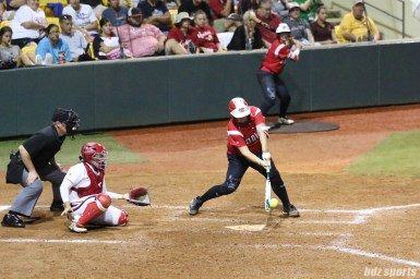 Scrap Yard Dawgs catcher Taylor Edwards (25) makes contact with the ball