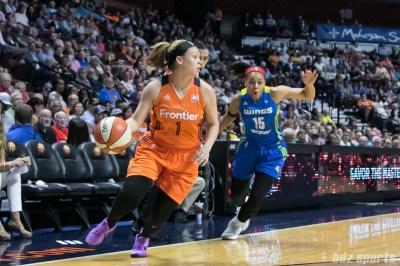Connecticut Sun guard Rachel Banham (1) controls the ball for the Sun.
