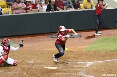 Scrap Yard Dawgs second baseman Hannah Flippen (1) lays down a bunt