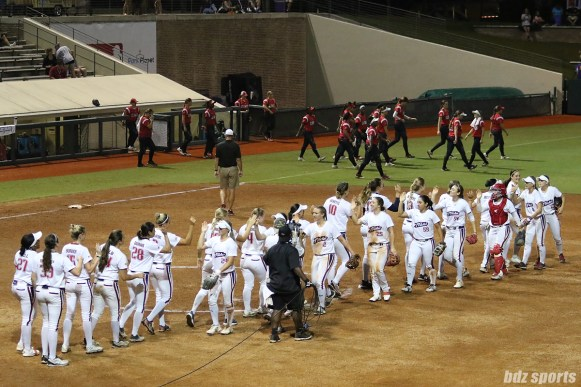 The USSSA Pride high five after defeating the Scrap Yard Dawgs 5 - 0 in NPF Championship Final Game 1