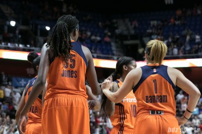 The Connecticut Sun huddle before the restart of play.