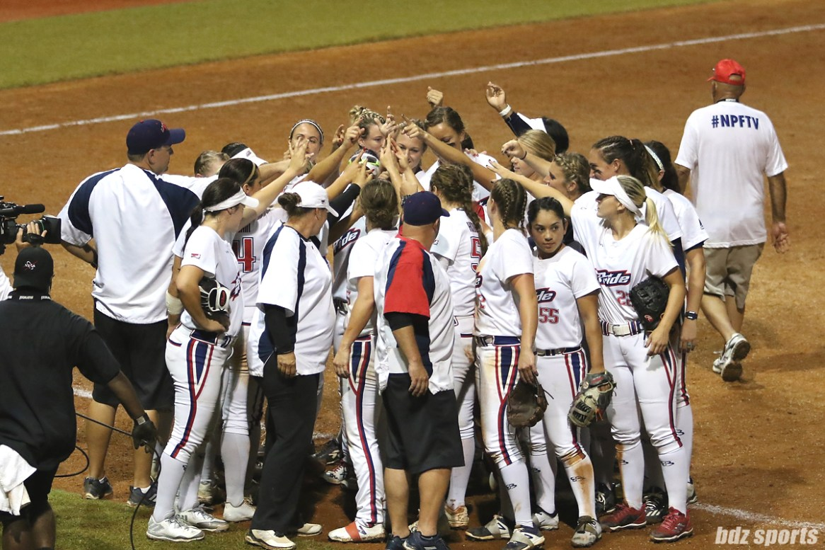 The USSSA Pride huddle to cheer after defeating the Scrap Yard Dawgs 5 - 0 in NPF Championship Final Game 1