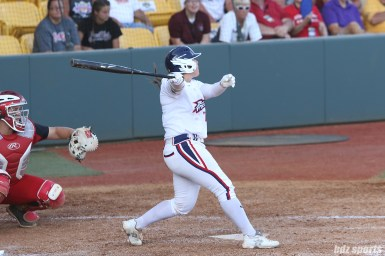 USSSA Pride Chelsea Goodacre (77) tracks the flight of the ball after hitting it into the outfield