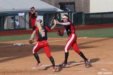 Scrap Yard Dawgs first baseman Britt Vonk (18) high fives pitcher Monica Abbott (14) after the last out in the inning