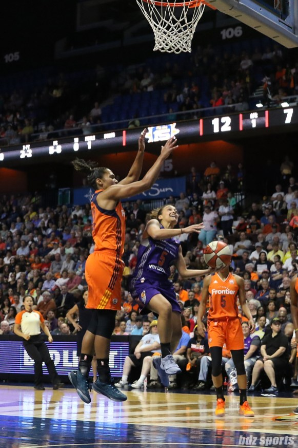 Phoenix Mercury guard Leilani Mitchell (5) goes for the layup while being defended by Connecticut Sun forward Alyssa Thomas (25)