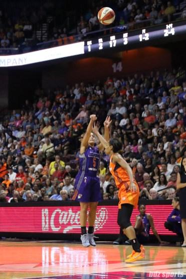 Phoenix Mercury guard Leilani Mitchell (5) takes a 3-point shot