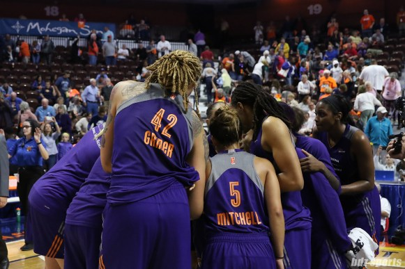 The Phoenix Mercury huddle after defeating the Connecticut Sun 88 - 83 and advance to round 3 of the WNBA playoffs