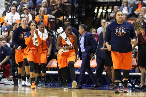 The Connecticut Sun bench is fired up during a timeout