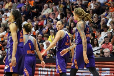 Phoenix Mercury guard Diana Taurasi (3) sticks her tongue out at teammate Brittney Griner (42)