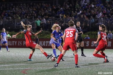 Portland Thorns FC midfielder Allie Long (10) and Boston Breakers midfielder Rosie White (10) go after a loose ball at the top of the box