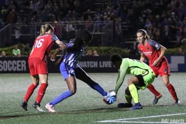 Boston Breakers forward Ifeoma Onumonu (22) challenges Portland Thorns FC goalkeeper Adrianna Franch (24) for the ball
