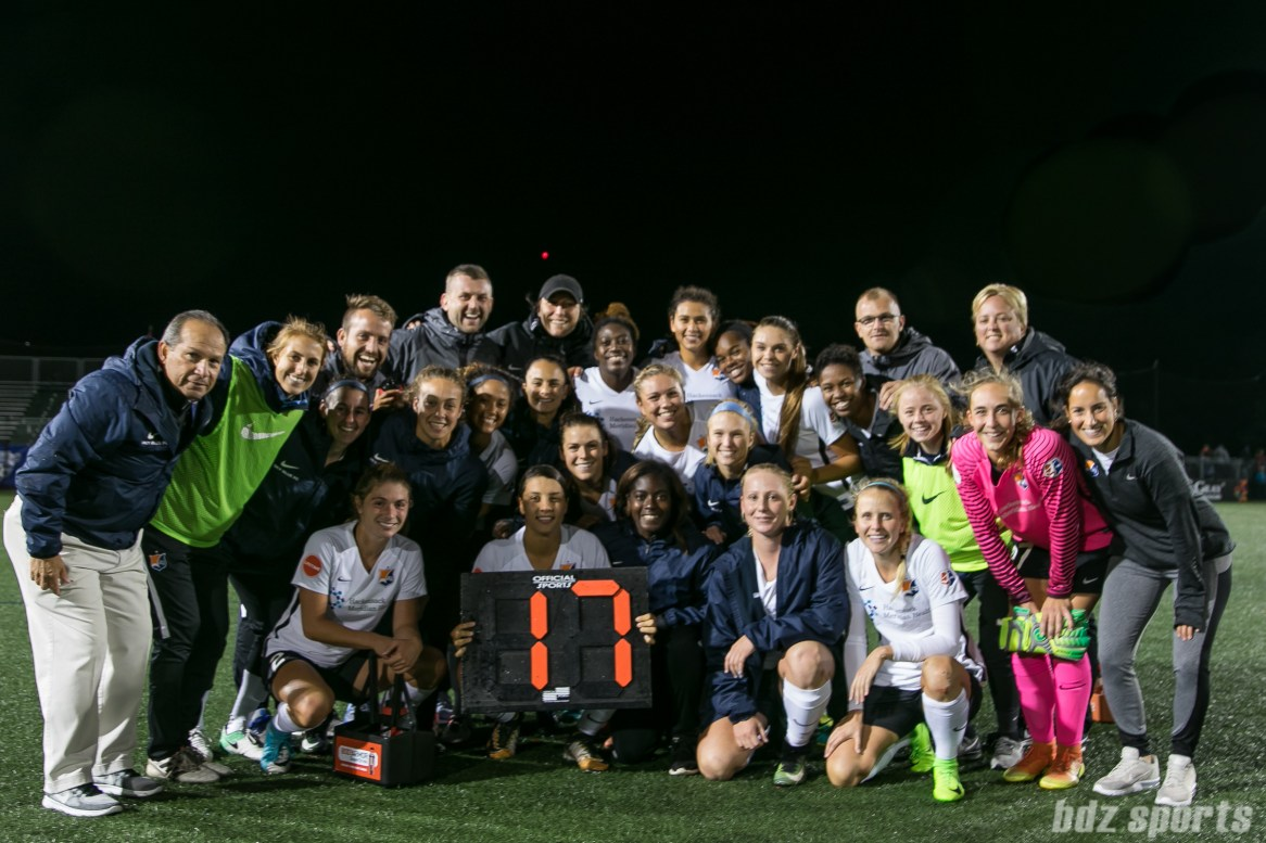 The Sky Blue FC celebrate Sky Blue FC forward Sam Kerr's (holding the sign) record breaking 17th goal of the season in Sky Blue's 4-3 win over the Boston Breakers