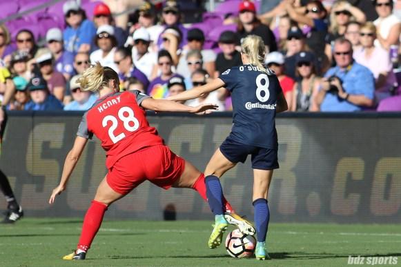 Portland Thorns FC midfielder Amandine Henry (28) battles North Carolina Courage midfielder Denise O'Sullivan (8) for the ball