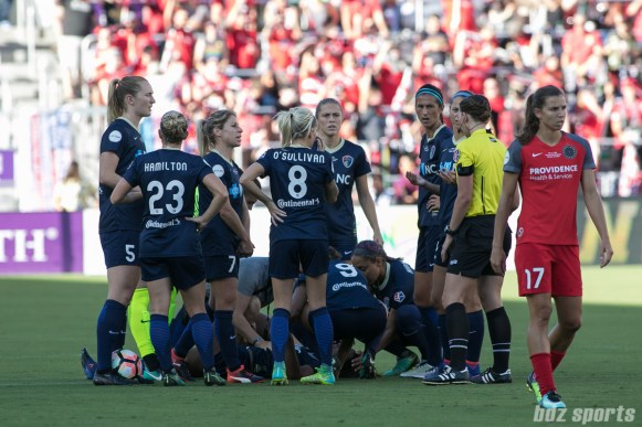 The North Carolina Courage huddle around injured teammate Taylor Smith