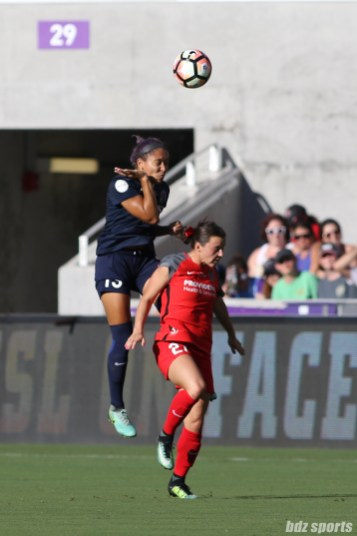 North Carolina Courage defender Jaelene Hinkle (15) heads the ball over Portland Thorns FC forward Hayley Raso (21)