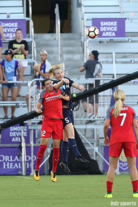 Portland Thorns FC forward Christine Sinclair (12) and North Carolina Courage midfielder Sam Mewis (5) battle for a ball in the air