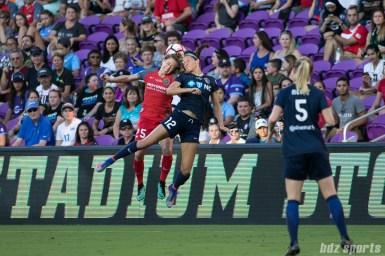 Portland Thorns FC defender Meghan Klingenberg (25) and North Carolina Courage forward Ashley Hatch (12) battle for a ball in the air