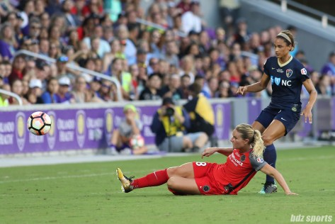 Portland Thorns FC midfielder Amandine Henry (28) slide tackles the ball away