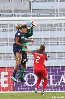 North Carolina Courage forward Jessica McDonald (14) challenges Portland Thorns FC goalkeeper Adrianna Franch (24) for a ball crossed into the box