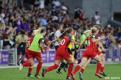 Portland Thorns FC players rush the field after the final whistle is blown