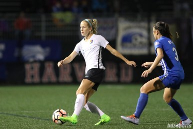 Sky Blue FC midfielder Nikki Stanton (7) controls the ball for Sky Blue as Boston Breakers defender Brooke Elby (3) defends